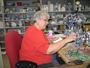 See artists make Delftware and wooden shoes