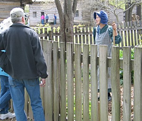 New Salem visitors learn about life in Lincoln's time from a costumed volunteer