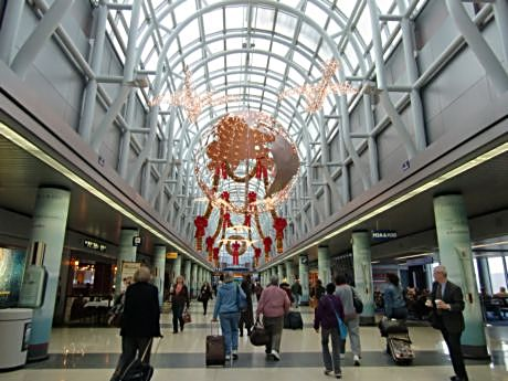 Travel on the holiday or off-peak hours for better rates and fewer crowds. Photo is AA terminal at O'Hare Airport.