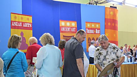 Antiques Roadshow Chicago visitors wait near the appropriate table to see an appraisal expert.