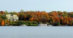 See fall color by boat in Lake Geneva. Photo compliments of Visit Lake Geneva