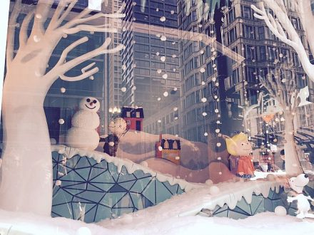 Past scene in Macy's holiday window with a Charlie Brown theme and reflections from downtown buildings. (J Jacobs photo)
