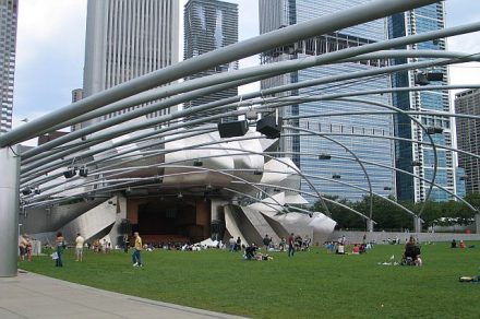 Frank Gehry's designed Pritzker Pavilion in Millennium Park has music festivals but the lawn in front is a place for exercizes early in the morning and where people relax later in the day. (J Jacobs photo)